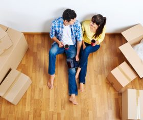 Couple sitting in new home resting Stock Photo