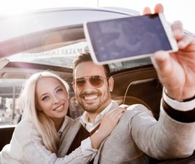 Couple sitting in the car selfie Stock Photo