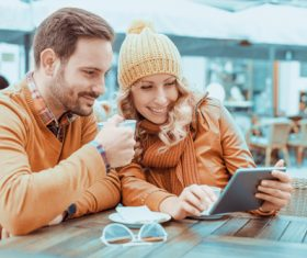 Couple watching videos together at the cafe Stock Photo