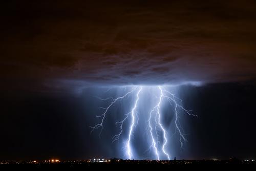 Cumulonimbus and lightning over the city Stock Photo 02