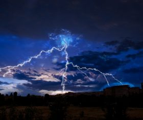 Cumulonimbus and lightning over the city Stock Photo 03