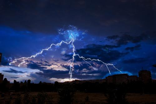 Cumulonimbus and lightning over the city Stock Photo 03