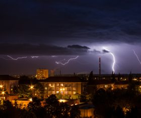 Cumulonimbus and lightning over the city Stock Photo 04