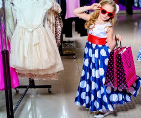 Cute little girl posing in the mall Stock Photo