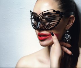 Cute woman wearing black butterfly mask Stock Photo 01