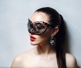 Cute woman wearing black butterfly mask Stock Photo 02