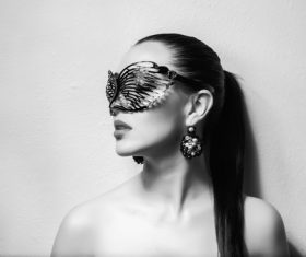 Cute woman wearing black butterfly mask Stock Photo 03