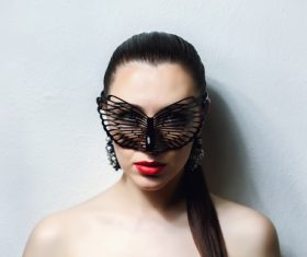 Cute woman wearing black butterfly mask Stock Photo 04
