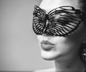 Cute woman wearing black butterfly mask Stock Photo 05