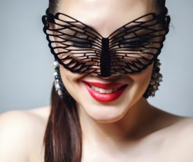 Cute woman wearing black butterfly mask Stock Photo 06
