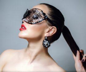 Cute woman wearing black butterfly mask Stock Photo 07