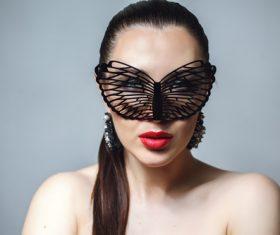 Cute woman wearing black butterfly mask Stock Photo 08