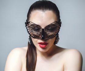 Cute woman wearing black butterfly mask Stock Photo 09