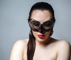 Cute woman wearing black butterfly mask Stock Photo 10