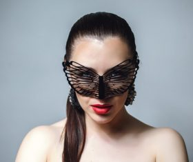 Cute woman wearing black butterfly mask Stock Photo 11