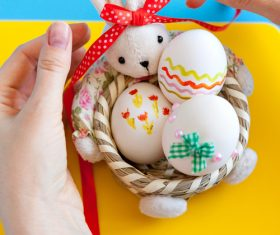 Decorative basket and easter eggs Stock Photo