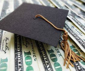 Dollar under the graduation cap Stock Photo