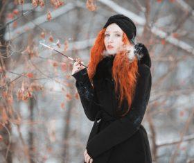 Dress up Hipster smoking redhead girl Stock Photo