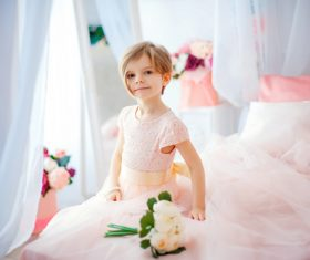 Dressed up beautiful little girl sitting on the bed Stock Photo 08