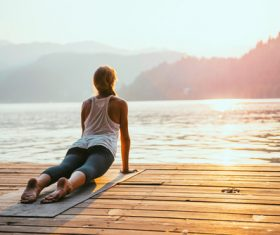 Early morning woman practicing yoga by the lake Stock Photo 07