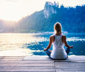 Early morning woman practicing yoga by the lake Stock Photo 09