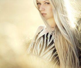 Elegant shawl blonde girl backlight photography Stock Photo