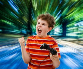 Excited boy playing games Stock Photo