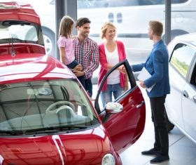 Family buying new car Stock Photo