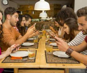 Friends party using mobile phone together Stock Photo 01