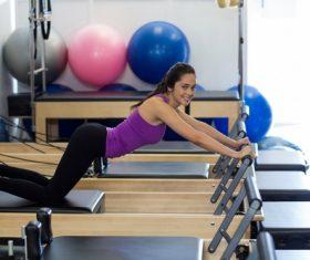 Girl doing abdominal exercises Stock Photo