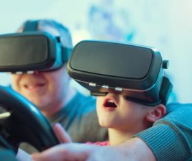 Grandpa and grandson playing games with VR Stock Photo 01