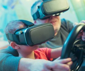 Grandpa and grandson playing games with VR Stock Photo 02