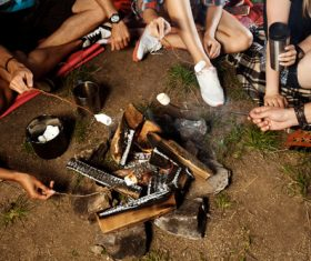 Grilling food on a campfire Stock Photo 02