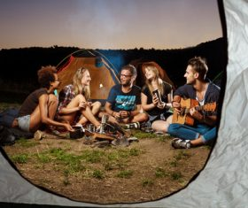 Happy friends camping Stock Photo