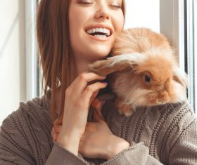 Happy girl and rabbit Stock Photo