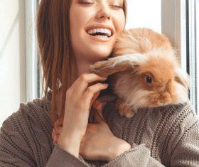 Happy girl and rabbit Stock Photo