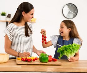 Happy mother and daughter in the kitchen Stock Photo 01