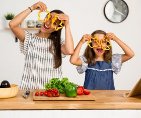 Happy mother and daughter in the kitchen Stock Photo 02