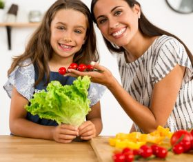 Happy mother and daughter in the kitchen Stock Photo 03