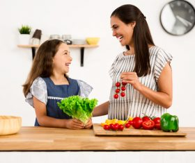 Happy mother and daughter in the kitchen Stock Photo 04
