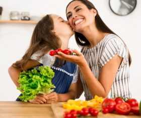 Happy mother and daughter in the kitchen Stock Photo 05