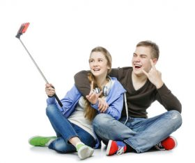 Happy teen boy and girl using a smartphone selfie Stock Photo 01