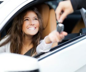 Happy woman buying new car Stock Photo 01