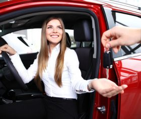 Happy woman buying new car Stock Photo 02