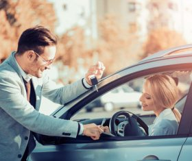 Happy woman buying new car Stock Photo 03