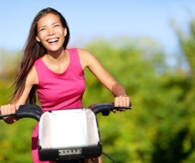 Happy woman riding bicycle Stock Photo