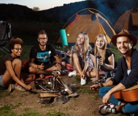 Happy young friends camping Stock Photo
