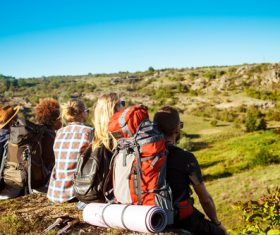 Hikers sitting down to rest Stock Photo