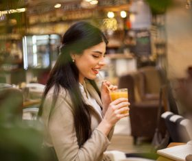 Lady drinking juice Stock Photo