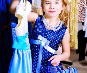 Little girl buying new clothes Stock Photo